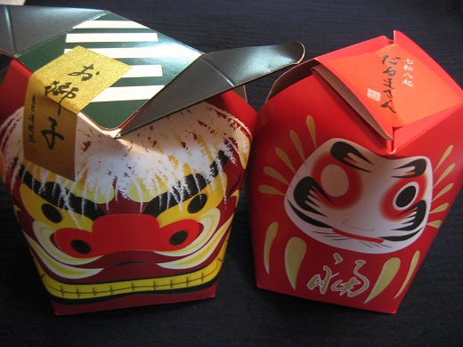 Japanese sweets packaging in a Shishi and a Daruma
