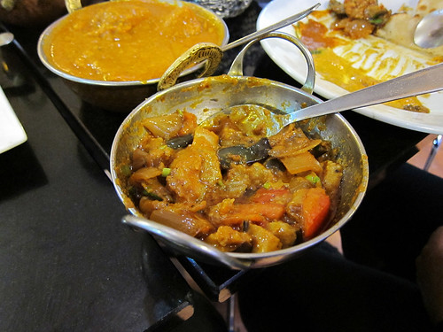 Selection of curries: fish curry and eggplant curry