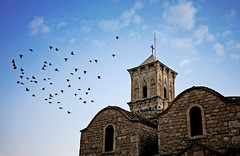 (ssj_george) Tags: sky building tower history church saint birds architecture clouds easter lens temple four lumix flying cross bell pigeons cyprus panasonic holy micro historical pancake 20mm thirds larnaca lazarus f17 gf1    georgestavrinos  ssjgeorge