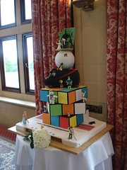 80's Themed Wedding Cake - Full View 3 (Alexandra Waite) Tags: wedding cake weddingcake barbie 80s sloth fraggle karatekid carebear smurf mrt themed doc goonies gizmo et teenwolf fragglerock ghostbusters indianajones gremlins ferrisbueller heman caddyshack backtothefuture mylittlepony rubikscube ateam bananaman rainbowbrite cassettetape superted staypuft cheerbear castlegrayskull 80scake 80sthemecake 80sweddingcake 80sthemedweddingcake 80sthemeweddingcake