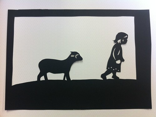 Silhouette of Lucy and lamb
