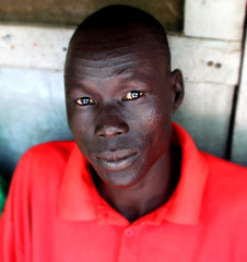 Nuer Man (LindsayStark) Tags: africa travel portrait people man war conflict ethiopia humanrights humanitarian displaced humanitarianaid nuer waraffected conflictaffected gambella