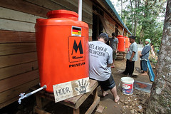 HODR volunteers install rainwater systems at an IDP camp for earthquake survivors in West Sumatra, Indonesia