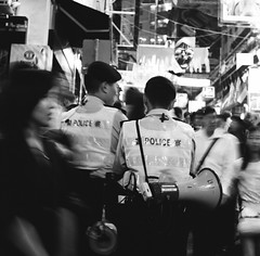 The thin blue line. (ndnbrunei) Tags: blackandwhite bw 120 6x6 tlr film halloween rollei mediumformat square hongkong kodak streetphotography bn mf lankwaifong backstreets xenar rolleicord classicblackwhite analoguephotography rolleigallery beginnerstreetphotography ndnbrunei tmy2 kodak400tmy2 50yearoldcamera ilovemyrolleicord acinematicworld