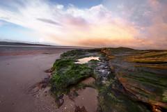 Red Rocks- dawn (Ray Woolley) Tags: winter red sky reflection water dawn coast seaside rocks pentax sigma thunderstorm wirral westkirby k10d justpentax