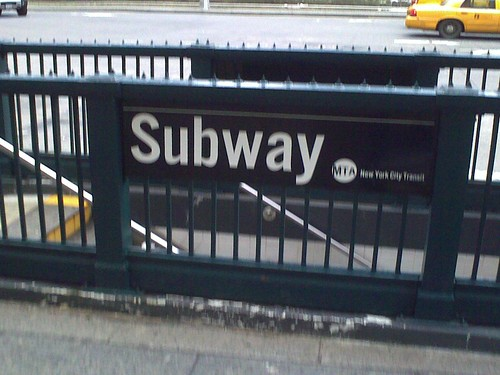 Bad signage at the 59th Street–Columbus Circle station, complete with improperly-redrawn MTA logo