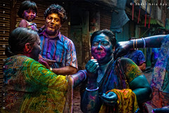 let them play the spring... ( (double-A Apu)) Tags: family colors spring women child play husband wife dhaka holi springfestival shakharibazar holi2010 holifamily holiatbangladesh