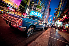 79.365 - Chevy Chase (Josh Liba) Tags: street city nyc newyorkcity travel cruise blue sunset urban ny streets classic chevrolet colors car night reflections project ads lights vanishingpoint interesting nikon colorful neon bright sweet awesome wideangle 66 grill tokina explore chevy adobe timessquare chase empirestate 365 bling impala rims fp frontpage lowrider f28 flashy lightroom caprice d90 explored 1116mm joshliba