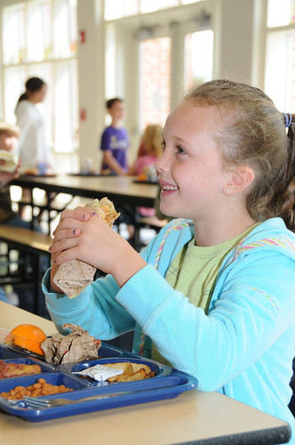 Ryvers, a Mount Lebanon Elementary School student, enjoys a Crunchy Hawaiian Chicken Wrap, her school's entry for the First Lady's Recipes for Healthy Kids Challenge.