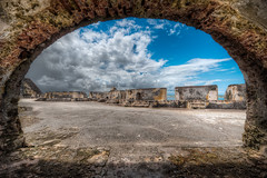 Shelter From The Storm - (HDR San Juan, Puerto Rico) (blame_the_monkey) Tags: travel detail castle texture architecture photoshop puerto photo nikon tripod wideangle pic architectural rico sanjuan blended nik digitalphoto hdr highdynamicrange viejosanjuan elmorro hdri blend topaz photoshopeffect postprocessing travelphotography travelphoto photomatix digitalblending tonemapped tonemapping 1424 hdrphoto niksoftware detailenhancer d700 topazadjust blamethemonkey elilocardi elialocardi