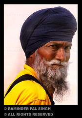 Portrait of a Singh (Raminder Pal Singh) Tags: orange india yellow beard eyes eyecontact expression brightcolors sikhs turban sikh apc amritsar cci sikhism afc pca wiseman singh strands kirpan canon70200 canonshot raminder damala wiseoldman canon50d amritsari piercinglook canon70200f4lisusm bestportraits anindianportrait flickrsbest sikhman dumala raminderpalsingh bestofportraits memorycornerportraits shotonacanon portraitofasikh lookingstraightatyou domala flickrsbestportraits portraitshotofaman brightattire cameraclubofindia