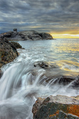 A Dramatic Sky and a Little Waterfall (DavidFrutos) Tags: sea orange costa sun seascape david water stone clouds sunrise landscape dawn coast mar waterfall agua rocks waves stones sony wave playa paisaje murcia amanecer filter alfa alpha filters naranja olas cabodepalos rocas ola filtro sigma1020mm cokin filtros nd8 p121s sonydslr densidadneutra davidfrutos 700 calaflores