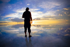 Male silhouette in the Salar de Uyuni, Bolivia (Camelot Photography Minnesota) Tags: travel sunset man reflection male southamerica water silhouette clouds surreal bolivia wideangle ambient saltflat salardeuyuni