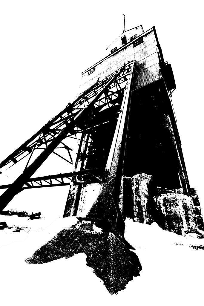 A black and white image of an abandoned mine building.