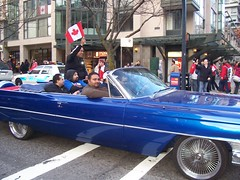 Hockey Victory: Vancouver 2010 Winter Olympics (cafechattycat) Tags: street blue winter red wild urban white canada men cars hockey car proud vancouver fun happy drive crazy driving flag wave victory celebration busy scream mapleleaf fans win olympics canadianflag oldcar celebrate vancouverbc homme closingceremony crowded bluecar boysgonewild streetparty downtownvancouver honking vancouverparty vancouvercanada bluecadillac vintagecadillac wildcanadians vancouver2010winterolympics happycanadians menincar vancouvercelebrates mengonewild canadacelebrates feb282010 vancouverstreetparty hockeyvictory carhonking