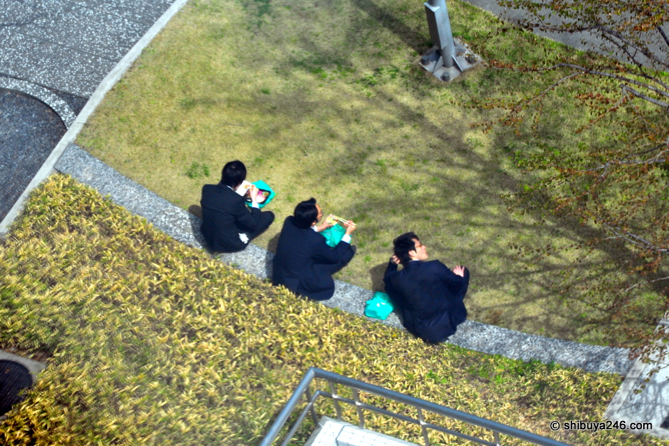 Looks like 3 happy salarymen here enjoying the fine weather with their bento lunches.