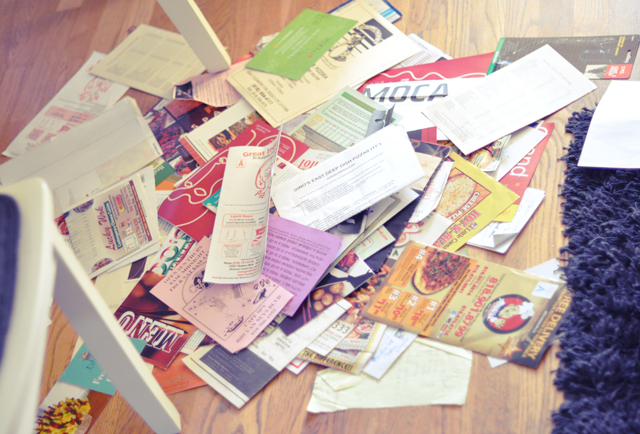 take out menus on the kitchen  floor + trash