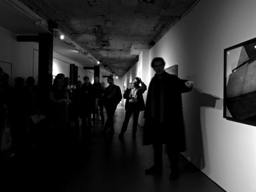 Curator TKTK walks guests through the show during his opening remarks.