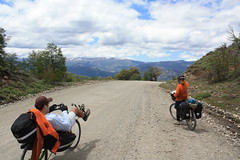 Roland and Malena riding ripio to catch the ferry - San Martin de Los Andes (Houston Marsh) Tags: travel vacation people holiday southamerica argentina bike bicycle cycling cyclist tour cycle roland touring malena biketour vagabond