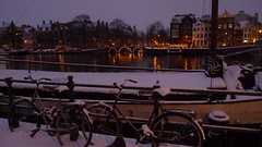 Winter in Amsterdam (Kirsteeen) Tags: winter white snow water amsterdam boat bikes amstel 2010 winterinamsterdam