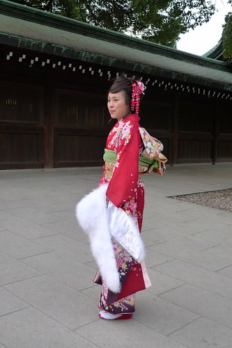 Chinese girl in striking red kimono