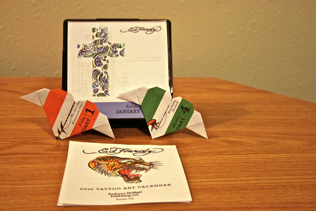 I'm using the 2010 Ed Hardy Tattoo Art Calendar to craft origami.