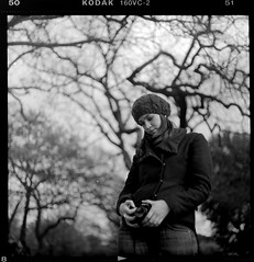 Imagine Another World (NyYankee) Tags: camera trees bw rome 120 6x6 film girl hat mediumformat bokeh cecilia analogue f28 kodakportra160vc p6 pentaconsixtl carlzeissjenabiometar80mmf28