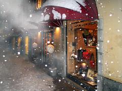 Snow walking (angelocesare) Tags: street light white mist snow shop fog snowflakes evening strada negozio neve flakes nebbia bianco luce sera fiocchi legnano angeloamboldiphotos