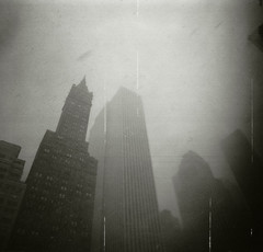 city snowstorm (scott w. h. young) Tags: nyc newyorkcity sky snow storm 120 film up clouds buildings mediumformat manhattan delta midtown diana tall flakes dianaf 3200 ilford soar 38mm
