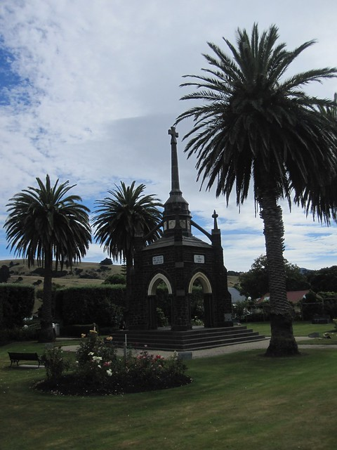 Akaroa 6 - European looking monument flanked by palm trees by Ben Beiske