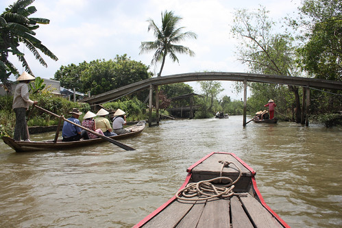 Being rowed down a Mekong Tributary