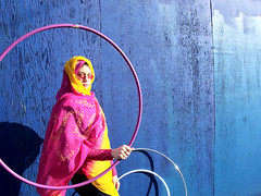 Woman With Hula Hoops (cafechattycat) Tags: pink blue woman yellow scarf femme hulahoops headscarf hulahoop