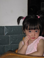 Shy but Curious Girl (ohmytrip) Tags: portrait cute girl face kids eyes child bright chinese shy curious lovely familygetty2010