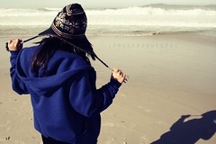 I Can Hear the Ocean (Sarah Ching) Tags: ocean blue winter shadow sea fall beach wool water hat hair pull back sand waves air salt footprints sunny jacket foam carmel ahir tug americanapparel hear lapis trisarahhtop