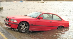 Car sub (first picture in the set) (esslingerphoto.com) Tags: red london wet thames parking bmw badday fireboat hightide carforsale floatingcar putney badparking bishopspark sinkingfeeling carinriver sinkingcar carforsail