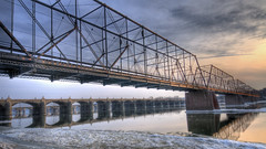 Harrisburg is an awesome place for bridge photography (*Jeffch) Tags: bridge sunset reflection river pennsylvania walnutstreetbridge hdr harrisburgpa susquehannariver archbridge marketstreetbridge trussbridge d300s