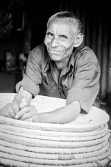 Basket seller (LindsayStark) Tags: africa travel portrait people man ethiopia humanrights humanitarian humanitarianaid waraffected conflictaffected gambella