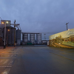 grain (steven-brooks) Tags: road street morning light usa industry rain america truck sunrise dawn lights early mural industrial cloudy empty gray grain overcast nobody american pacificnorthwest americana lonely tacoma roads roadside absent emptystreets grainery emptylot grayskies peoplelessness stevenbrooks americanny