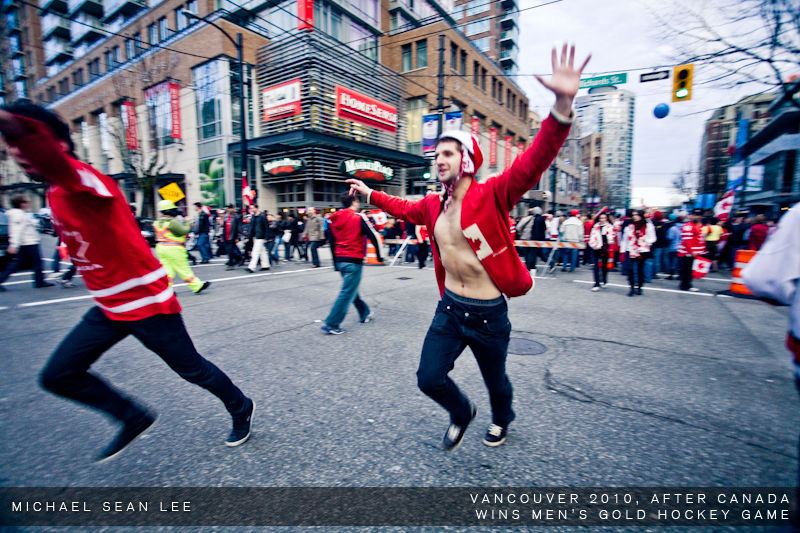 fans running on the street in vancouver after canada men's hockey game