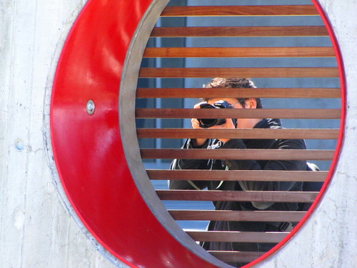 Photographer shoots through a public art structure at the Richmond Oval Spirit Square