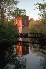 Dam at the golden hour (rexp2) Tags: bridge reflection abandoned flickr dam nikonf100 powerplant nikkormicro105mmf28 kodakektar100