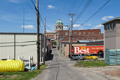 With the towering copper dome of the county courthouse in the distance!! (Tim Kiser) Tags: 1908 1908architecture 1908building 2015 20150429 april april2015 doitbest doitbestadvertisement doitbesttrailer img5879 monroecounty monroecountycourthouse monroecountyohio ohio ohiolandscape woodsfield woodsfieldohio woodsfieldcityscape woodsfieldtownscape alley alleylandscape backalley buildings cars cityscape clocktower commercialbuildings copperdome countycourthouse courthouse courthouseclocktower courthousedome distantclocktower distantcourthouse dome downtown downtownwoodsfield eastohio easternohio electriclines electricpoles greencopper greencopperdome landscape mostlysunny orangetrailer overheadelectriclines overheadpowerlines parkedcars pipe pipes plasticpipe plasticpipes plastictank powerlines southeastohio southeasternohio stopsign telephonepoles townscape trailer utilitypoles view yellowplastic yellowtank unitedstates