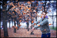 autumn leaves go away! (andreas gessl) Tags: autumn face leaves munich focus dof emotion action bokeh expression autumnleaves mimic throw throwing olympiapark twop bokehlicious flyingleaves freddiemercurystyle simonrechenmacher