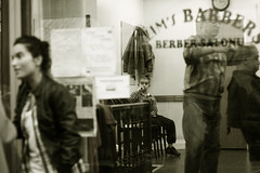 Behind the glass (Che-burashka) Tags: street boy woman haircut london waiting looking market citylife streetphotography streetlife east barber hackney barbers peeping eastend broadwaymarket throughthewindow selectivefocus behindtheglass londonist streetmarkets