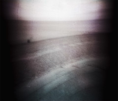 waiting for the sea (kycamlewis) Tags: bw distortion blur beach ilfordxp2 vignette expiredfilm longexposures pinholes unblended kycamlewis kylewis pinholblendermini35