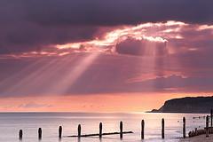 Rays over Pett Level (GriBBsY) Tags: winter sunset sea sun beach landscape sussex tide cliffs rays seashore winchelsea groynes pettlevel gribbsyweb