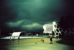 storm on a roof (mela.de.gypsie) Tags: roof storm film clouds lomo lca singapore kodak slide harbourfront ektachrome100 marche waterplayground project365 vivocity 135format