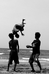 tumbling (.emong) Tags: people bw beach monochrome lumix jump philippines panasonic iba southchinasea zambales somersault lx3