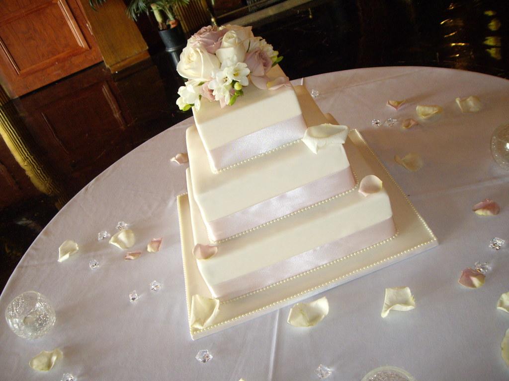 Ivory Wedding Cake with fresh flower topper