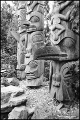Totems Vancouver Airport N1731e (Harris Hui (in search of light)) Tags: wood portrait bw canada texture monochrome vertical mystery vancouver mono blackwhite spring airport bc flight sigma richmond grayscale digitalbw totempoles yvr tones amateur legend sculptures vancouverairport totems aboriginalart nocolor sculptureart greytones woodencarving sigma1770mm northamericanaboriginalart woodsculptures ilovebw sigmazoomlens nikond300 spring2010 weekendpictures harrishui vancouverdslrshooter colordepleted vancouverwelcomesyou totemsvancouverairport mysteriouspower picturesinyourtown viewonblackisbetter